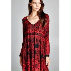 Long sleeve swing dress with deep scoop back. Beautiful red patterned dress. 90% polyester 10% spandex. Also available in Small and Medium. Dresses