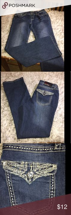 NWT XXI Bootcut Jeans Size 29 New with tags!  Bootcut jeans by XXI.  Medium blue rinse color.  Designed back pockets.  Size 29. Inseam is 33 inches long.  Important:   All items are freshly laundered as applicable prior to shipping (new items and shoes excluded).  Not all my items are from pet/smoke free homes.  Price is reduced to reflect this!   Thank you for looking! Forever 21 Jeans Boot Cut
