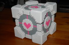 My pegboards: The cake is a lie - 3D Companion Cube perler instructions (Google is able to translate the page)