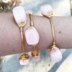 HP 4/29  Rose Quartz Bangle Handmade with Rose quartz stones & gold colored wire. 2.75 inches across. Tarnish resistant.  Listing is for (1) bangle. Any others pictured are for styling suggestions only & are sold separately. Sydney Elle Jewelry Bracelets