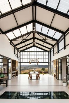 Open air dining area features polished concrete floors and high vaulted ceilings in this home outside of Pretoria, South Africa. Container Home Designs, Container House Plans, Conservatory House, Design Jobs, Design Ideas, Logo Design, Casas Containers, Architect House, Architect Logo