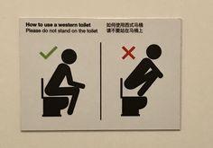 Sign on bathroom stall in the souvenir shop at Geysir, Iceland
