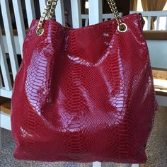 ❤️ MICHAEL KORS Sexy Snake Skin Leather Purse ❤️ ❤️Large, sexy, red, snake skin leather, MICHAEL KORS, purse.  Purse has long shoulder strap, magnetic snap closure, key ring strap, and 3 inside slip and 1 zip pocket.  Purse has beautiful gold chain accents on handles.  Excellent condition.  No stains, tears, or wear. Handles are in good condition.  I love love love this purse!!  14 X 12 X 4.  Shoulder strap drop 15 inches.  Nice gift!! Michael Kors Bags Shoulder Bags
