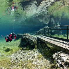 Green Lake — Tragoess, Austria. Green Lake is no ordinary park. Once a year, this park is submerged in water after all the snow on the Karst Mountains melts. It has become a popular attraction for scuba divers all over the world.