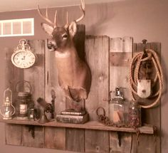 This one was my first true DIY.  Didn't even get help from husband.  Old barn wood, deer mount and miscellaneous vintage finds.
