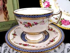 ROYAL DOULTON TEA CUP AND SAUCER PAINTED ROSES ARTIST SIGNED PATTERN TEACUP