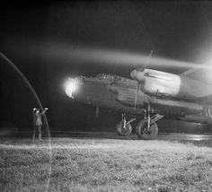 File:An Avro Lancaster Mk III of No. 49 Squadron RAF is guided to its dispersal point at Fiskerton, Lincolnshire, after returning from a raid on Berlin, 22 November 1943. CH11642.jpg