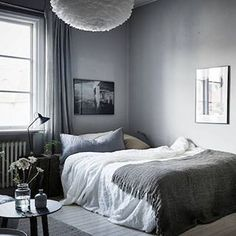 Embracing the grey inside and out today with this lovely Swedish space ❤. Full tour on blog (link in bio). @stadshem @fotografjonasberg styling @styledbyemmahos #grey #bedroom #swedishhomes #scandinavianhometour