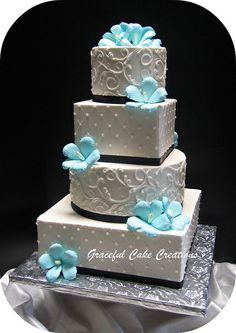 Tropical Hibiscus Wedding cake by Graceful Cake Creations, via Flickr