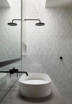 Textural tiles can be a good way to add interest....as can black tapware (but black might not date well over time ?)