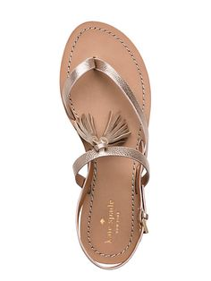 the tassels that top these strappy flat sandals make them special (and stylish); pair them with everything from tailored shorts to floaty sundresses.