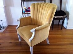 Cheerful, upholstered yellow lounge chair with Deco lines. $110.00, via Etsy.