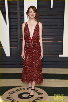 Emma Stone in an Altuzarra dress, Christian Louboutin heels, Bottega Veneta clutch, and Tiffany&Co. jewels.