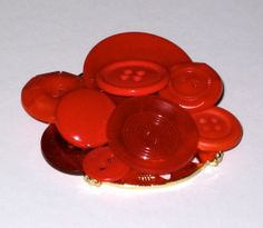 'Varied Red Button Brooch' is going up for auction at 10am Sun, Jul 28 with a starting bid of $2.
