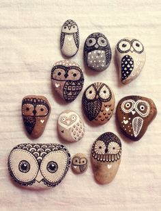 Rocks painted to make owls