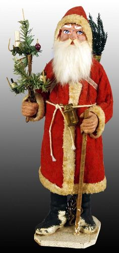 Christmas Candy Container Santa with a electrified feather tree. Runs by a battery pack.has a staff in his hand. Z