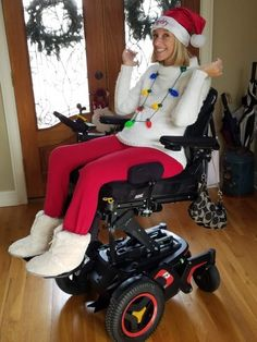 Ali in her electric wheelchair posing and smiling in white sweater, red pants, a Santa hat and Christmas lights around her as a necklace. Gifts For Elderly Women, Quadriplegic, Mobility Aids, Disabled People, Red Pants, Senior Gifts, Disability, Solo Travel, My Boyfriend