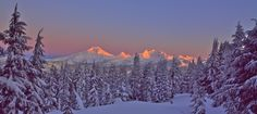 Stock image of alpenglow on the Three Sisters and broken Top as seen from Oregon's Tumalo Mountain