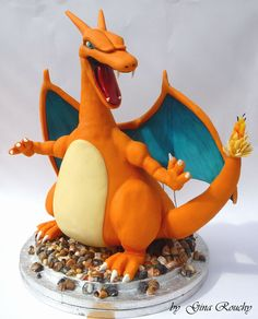 Charizard Pokemon Character Cake by *ginas-cakes on deviantART   Holy crap, this is beautifully done!  I wish I had half her talent!
