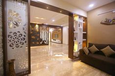 Home center Interiors creating stunning and elegant interiors .We reach our clients' expectations Glass Partition Designs, Living Room Partition Design, Living Room Divider, Pooja Room Door Design, Living Room Tv Unit Designs, Bedroom Cupboard Designs, Home Room Design, False Ceiling Living Room, Ceiling Design Living Room