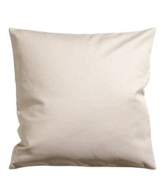 Light beige. Cushion cover in cotton canvas with concealed zip.