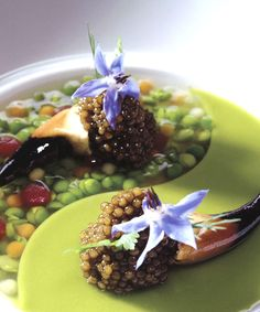 Ying yang with osetra and stone crab claws: Consommé of English peas contrasted with velouté of English peas from Benoît Violier's Restaurant de l'Hôtel de Ville in Crissier, Switzerland.