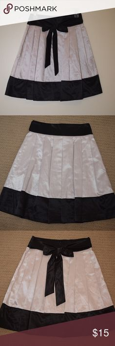 Forever21 Satin Pleated Skirt with Bow Tie Sash This luxurious satin skirt features a high quality finish with pleated design,  banded high waist band with hidden back zipper closure,  bow tie sash detail along the back, and a hemline that hits mid thigh. Forever 21 Skirts