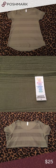 NWOT Olive Green Classic Tee Olive green classic tee. The stripes are textured. This is new without tags. LuLaRoe Tops