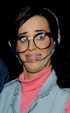 Katy Perry as a #nerd...I think she looks better this way! She can open cans with that apparatus.