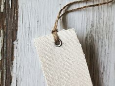 Handmade hang tags from 100% cotton canvas, ready to stamp your logo on them…