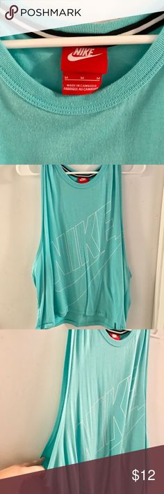 Nike tank top Baby blue nike tank top. I've worn it a handle full of times. The sides are super low cut, too low for me. Great workout shirt. Nike Tops Tank Tops