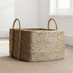 Free Shipping.  Shop Tyler Square Basket with Rope Handle.  Nestle magazines, linens, towels or pillows in an artisan-crafted storage solution, hand-woven in great chunky coils from water hyacinth stems, a natural, bountiful resource.