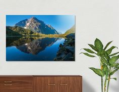 Discover «Mountain View Reflections in Water at Milford Sound», Numbered Edition Aluminum Print by Daniela Constantinescu - From $74.9 - Curioos