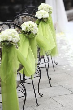 Green tulle and cream flowers for the aisle
