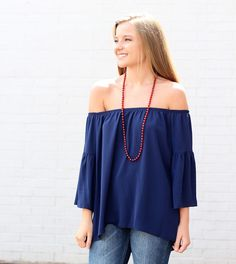 Our off the shoulder tops are perfect for game day! Come see us and let us style you for tomorrow's game #lotusboutique