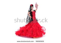 a typical spanish doll dressed as a flamenca isolated on a white background