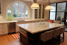 Kitchen countertop and island with light colored granite.