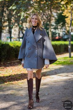 gray cape with statement boots