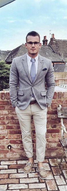 Menswear blogger Charlie Irons suits up in a gray blazer and flat-front chinos to bring our boat shoes to the next level. Dressed up with class and style, Charlie's look is accented perfectly with a soft lavender shirt and purple tie showing off his skill in rocking classic style in a men's suit. @charlieirons