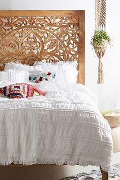 I adore everything about this hand carved Anthropologie headboard and Corded Duvet Cover #anthropologie #sponsored