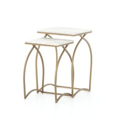 High functioning nesting tables get dressed up as hard marble graces softly curved, brass nesting legs. The perfect touch of glamour to add to your space.