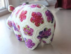 Soooooo pleased with how she turned out. I put the finishing touches on her last night - a little red li. Crochet Hippo, Cute Crochet, Crochet Crafts, Crochet Toys, Crochet Baby, Crochet Projects, African Flower Crochet Animals, Crochet Flowers, Yarn Animals