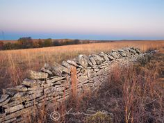Tallgrass Prairie National Preserve, Flint Hills, Kansas<br /> Originally made to mark boundaries and retain livestock, these stone fences built in the 1800's can last 200 years. A state statute of February 20, 1867 said a landowner would be paid 40 cents per rod (16.5 feet) to build and maintain a 4.5 foot tall stone fence. Its hard to imagine the hourly pay rate to build 40 cents worth of fence!!! I can't imagine that it would take any less than several days to collect and build that much…