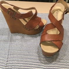 BROWN LEATHER STRAPPY PLATFORM STUD WEDGES Adorable brown leather strappy platform summer wedges! Gold studs on sides that complete the trendy look! Nude color & shape of wedges elongates legs- perfect for mini dress or skirt or even with jeans! Lightly worn, otherwise in great condition Zigi Soho Shoes Wedges