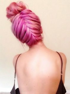 Purple pink braided up dyed hair in bun style