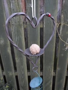 Quality Hand Crafted Wrought Iron (Forged Steel) Heart Bird Feeder Kit With Unique Ladybird /Ladybug Feature. Bird Feeders Uk, Forging Metal, Forged Steel, Wrought Iron, Ladybug, Backyard Ideas, Pot Holders, Feather, Crafts