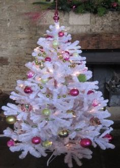 Pink and Green decorations on White tree.