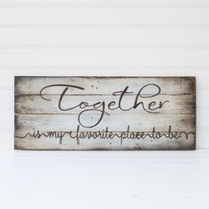 Together is my favorite place to be on reclaimed pallet wood board. Size: Item measures 40x15  Colors: Background is antique white Lettering is dark walnut stain  Board is sealed with a clear, flat finish and back is left unfinished. Item comes ready to hang