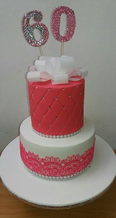 Pink and white wafer bow 60th cake