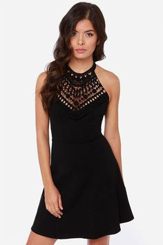 The Lace In the Right Place Black Halter Dress has all the signs of a great design, with a beauti...